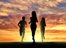 Competition runners athletes at sunset Royalty Free Stock Image