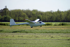 Competition sailplane. Taking off from a grass field Royalty Free Stock Photos