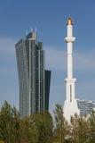 Competition: Skyscraper vs. Minaret Stock Image