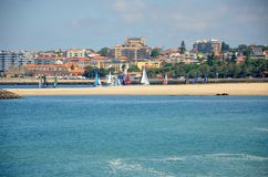Competition of small sailing boats near the city of Porto Royalty Free Stock Images