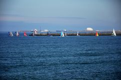 Competition of small sailing boats near the commercial port of Porto Royalty Free Stock Images