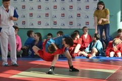 Competition.sport. An image of two pupils on sambo competitions Royalty Free Stock Photography