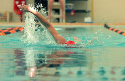 Competition swimmer. Doing freestyle Stock Photo