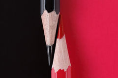 Competition, teamwork, partnership concept, black and red pencil on paper Royalty Free Stock Photography