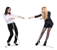 Competition. Two business women in competition pulling rope isolated on white background Royalty Free Stock Photo