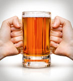 Competition of two hands with beer in glass Stock Photos