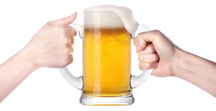 Competition of two human hands with beer in glass Stock Photos