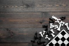 Competition or victory or strategy concept. Chess board and chess figures on dak wooden background top view copy space. Competition or victory or strategy stock photos