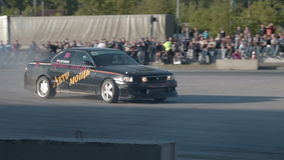 Competitions on car drift. NOVOSIBIRSK, RUSSIA - JUNE 03, 2016: Two sport cars performing drift during competitions in the city stock video footage