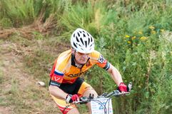 Competitions cyclists in cross-country Royalty Free Stock Photo