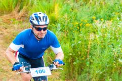 Competitions cyclists in cross-country Royalty Free Stock Image
