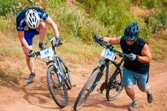 Competitions cyclists in cross-country Stock Photos
