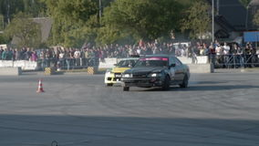 Competitions on drift. NOVOSIBIRSK, RUSSIA - JUNE 03, 2016: Sport cars performing paired drift during the competitions stock video