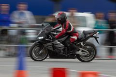 Competitions in the figured driving of a motorcycle with obstacles Royalty Free Stock Image