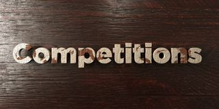 Competitions - grungy wooden headline on Maple  - 3D rendered royalty free stock image. This image can be used for an online website banner ad or a print Stock Image