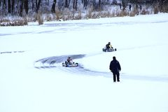 Competitions of Kart racing on the ice of river royalty free stock photo