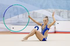 A young teenager girl performs at competitions in rhythmic gymnastics. Royalty Free Stock Photography