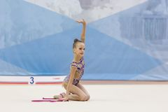 A young teenager girl performs at competitions in rhythmic gymnastics. Competitions in rhythmic gymnastics, Russia, September 2017 Stock Photography