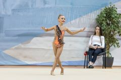 A young teenager girl performs at competitions in rhythmic gymnastics. Competitions in rhythmic gymnastics, Russia, September 2017 Royalty Free Stock Images