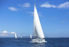 Competitions at sea on luxury yachts - a sport for courageous people. Luxury yachts. Competitions at sea - a sport for courageous people stock photography