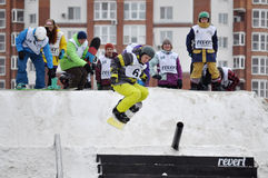 Competitions of snowboarders in the city Stock Photos