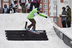 Competitions of snowboarders in the city Stock Photo
