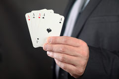 Competitive Advantage. Four Aces in Businessman hand Royalty Free Stock Images