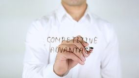 Competitive Advantage, Man Writing on Glass, Handwritten Stock Photos