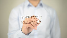 Competitive Advantage, Man writing on transparent screen Stock Image