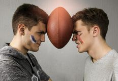 Competitive brothers american football portrait Royalty Free Stock Photo