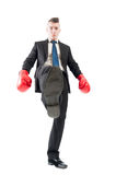 Competitive business man tread over the competitors. Competitive and aggresive business man tread over the competitors concept on white background Stock Photos