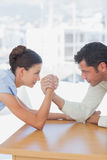Competitive business people arm wrestling Royalty Free Stock Photos