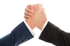 Competitive business people arm wrestling Stock Photo