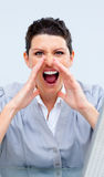 Competitive business woman yelling Royalty Free Stock Photos