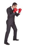 Competitive businessman in boxing gloves Stock Image