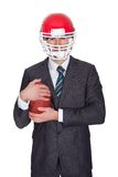 Competitive businessman playing american football Stock Images