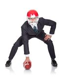 Competitive businessman playing american football Royalty Free Stock Photo