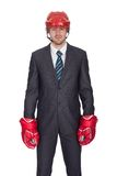 Competitive businessman wearing hockey equipment Royalty Free Stock Photo