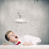 Competitive concept. Businessman screaming at businesswoman standing on cloud Stock Photo