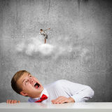 Competitive concept. Businessman screaming at businesswoman standing on cloud Stock Images