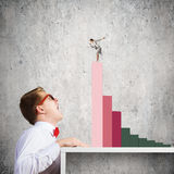 Competitive concept. Businessman screaming at businesswoman standing on top of graph Royalty Free Stock Photos