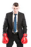 Competitive corporate boss wearing boxing gloves Royalty Free Stock Photography