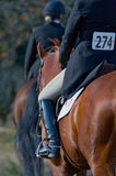 Competitive horse riders. A partial view of two horses and riders in a jumping competition or trial Stock Photography