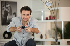 Competitive man playing video games stock image