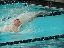 Competitive Swimmer. A student swimmer races in a competitive swim meet at school Stock Images
