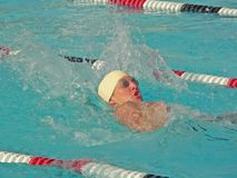 Competitive Swimmer. A student swimmer races in a competitive swim meet at school Stock Photography