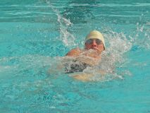 Competitive Swimmer. A student swimmer races in a competitive swim meet at school Royalty Free Stock Photography
