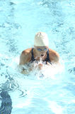 Competitive Swimmer. A young athletic female swimmer practing for competitive swimming Stock Photo