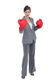 Competitive woman with red boxing gloves Royalty Free Stock Photo