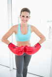Competitive woman wearing red boxing gloves Stock Photography